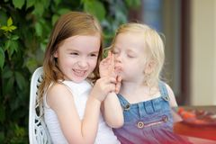 Two little sisters having fun Stock Images