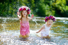 Two little sisters having fun by a river Royalty Free Stock Photo