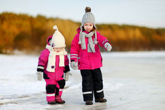 Two little sisters having fun on snowy winter day Stock Photography