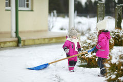Two little sisters having fun on snowy winter day Royalty Free Stock Photo
