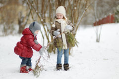 Two little sisters having fun on snowy winter day Royalty Free Stock Photography