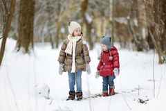 Two little sisters having fun on snowy winter day Royalty Free Stock Images