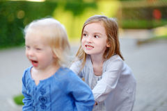 Two little sisters having fun on a summer day Royalty Free Stock Images