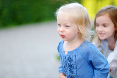 Two little sisters having fun on a summer day Royalty Free Stock Photos