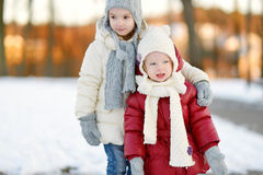 Two little sisters having fun on winter day Royalty Free Stock Photo