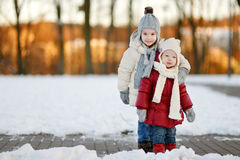 Two little sisters having fun on winter day Royalty Free Stock Photography