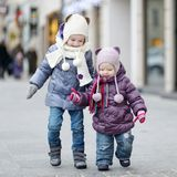 Two little sisters having fun on winter day Stock Photos