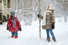 Two little sisters having fun on winter day Royalty Free Stock Image