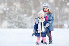 Two little sisters having fun at winter Royalty Free Stock Photography