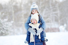 Two little sisters having fun at winter Stock Photos