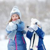 Two little sisters having fun at winter Royalty Free Stock Images