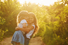 Two little sisters hugged strongly. Stock Image