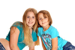 Two little sisters lying on the floor. Royalty Free Stock Photos