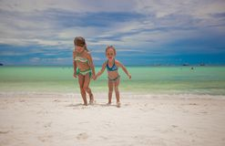 Two little sisters in nice swimsuits out of the Stock Image