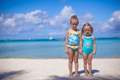 Two little sisters in nice swimsuits at tropical Stock Photos