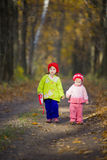 Two little sisters in the oak grove Stock Image