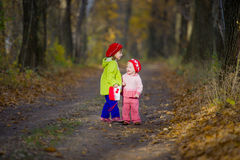 Two little sisters in the oak grove Stock Photography