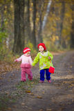 Two little sisters in the oak grove Royalty Free Stock Images