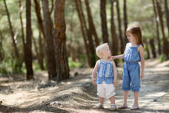 Two little sisters outdoors at summer day Royalty Free Stock Photography