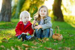 Two little sisters playing outside Stock Image