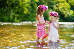 Two little sisters playing with paper boats Royalty Free Stock Photography