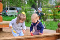 Two little sisters playing in  sandbox Stock Photo