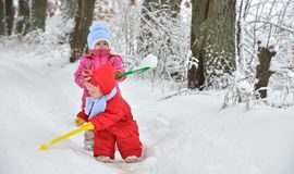 Two little sisters playing in the snow Royalty Free Stock Image