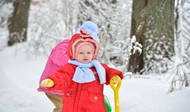 Two little sisters playing in the snow Stock Images