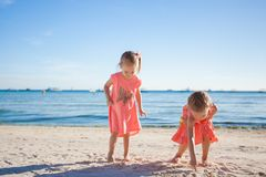 Two little sisters playing together on the white royalty free stock images