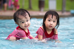 Two Little Sisters Playing in Water Royalty Free Stock Photos