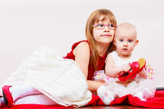 Two little sisters portrait. Stock Image