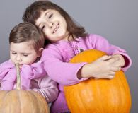 Two little sisters with pumpkin Royalty Free Stock Photos