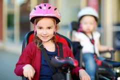 Two little sisters ready to ride a bike Royalty Free Stock Photo