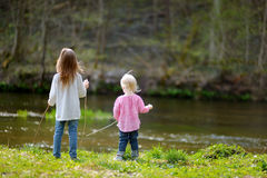 Two little sisters by a river Royalty Free Stock Photo
