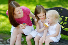 Two little sisters sharing delicious cream tart Royalty Free Stock Photos