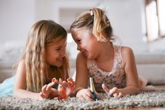 Two little sisters spending time together. royalty free stock photos
