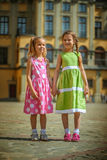 Two little sisters on street Stock Photos