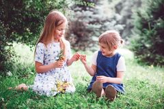 Two little sisters in summer day. Two funny little sisters walking in summer park royalty free stock photo