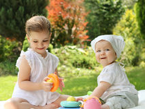 Two little sisters in the summer garden Royalty Free Stock Photo