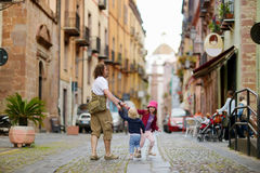 Two little sisters and their dad in italian town Royalty Free Stock Image