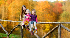 Two little sisters and their mom having fun Royalty Free Stock Image