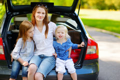 Two little sisters and their mother in a car Stock Image