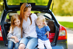 Two little sisters and their mother in a car Stock Photo