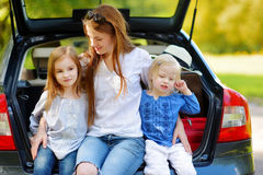 Two little sisters and their mother in a car Royalty Free Stock Images