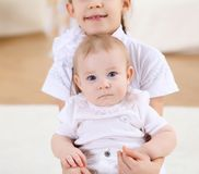 Two little sisters together at home Royalty Free Stock Image