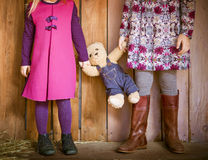 Two little sisters with toy bear Royalty Free Stock Photo