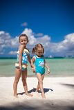 Two little sisters at tropical beach Stock Photo