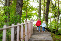 Two little sisters walking up stairs Royalty Free Stock Photos