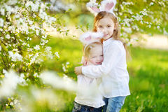 Two little sisters wearing bunny ears on Easter Royalty Free Stock Image