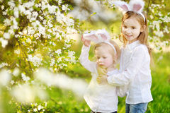 Two little sisters wearing bunny ears on Easter Stock Photos